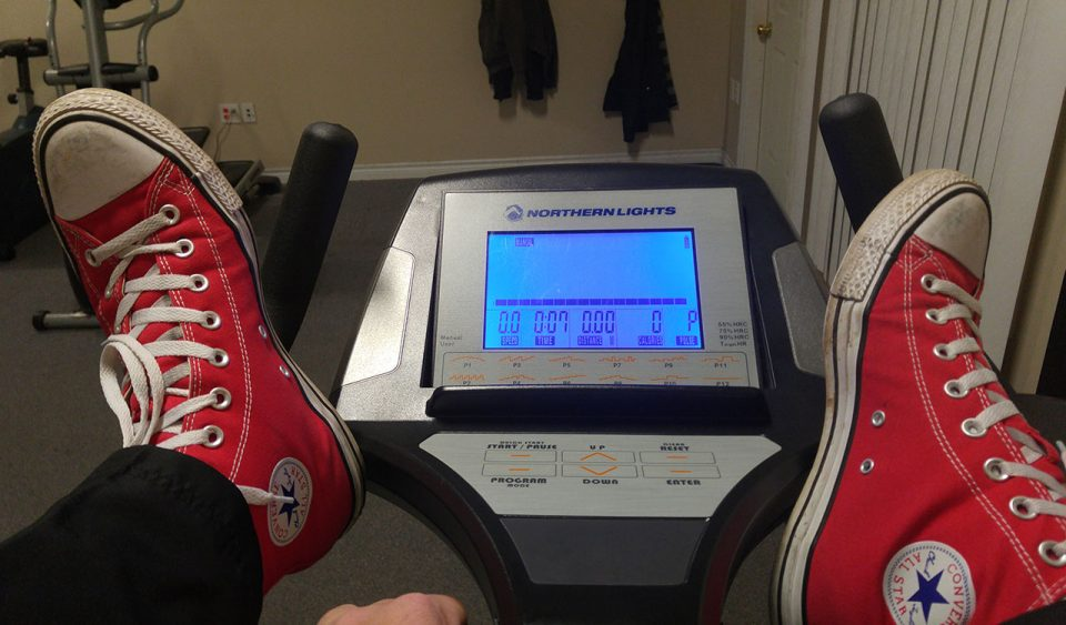 Feet up on exercise bike handles
