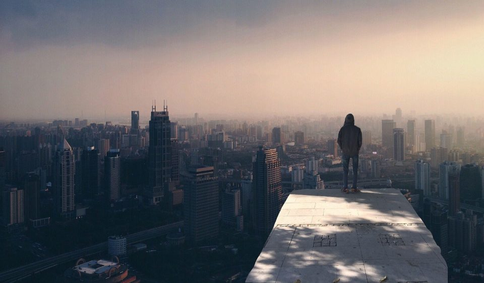 Lonely man overlooking city