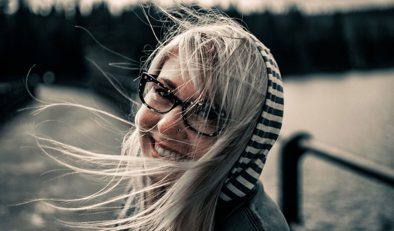 Smiling woman with blowing hair
