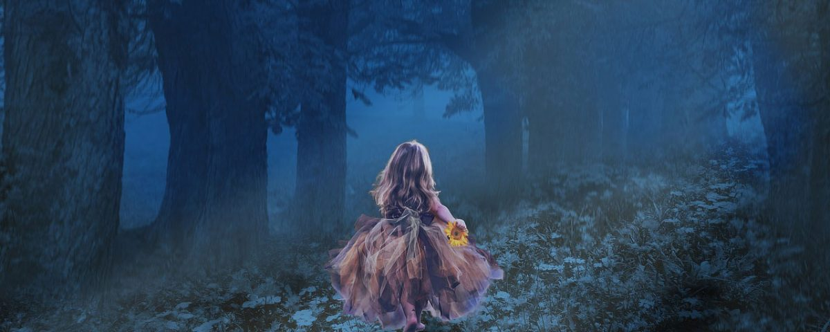 Little girl in dark woods