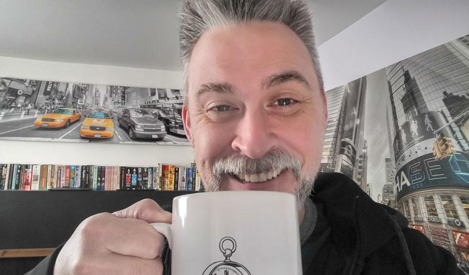 Smiling over a mug