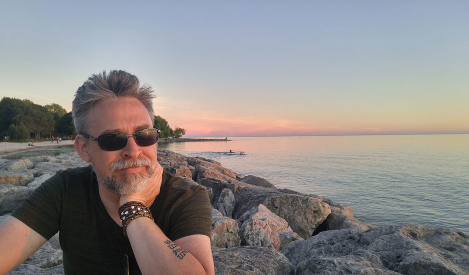 Thinking at sunset by the lake