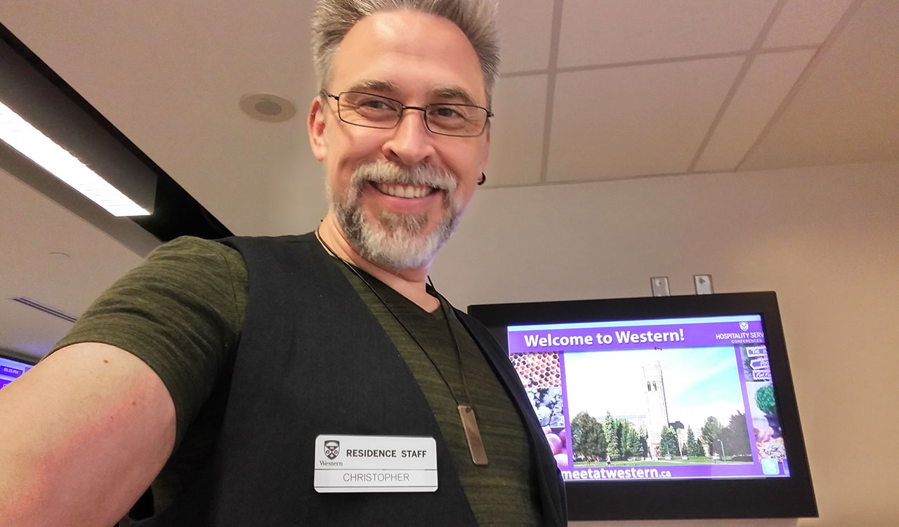 Posing with name tag at Western University