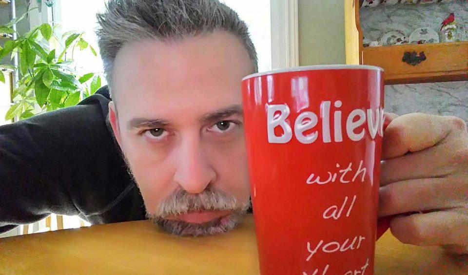 Grumpy morning coffee man