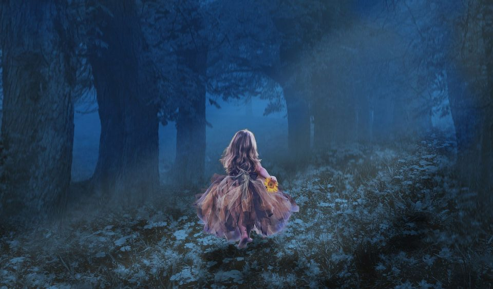 Little girl in dark woods